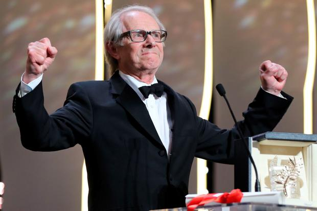 Ken Loach celebrates being awarded the Palme d'Or