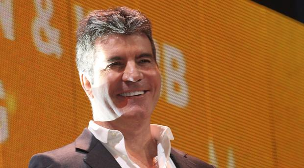 Simon Cowell and The X Factor team are