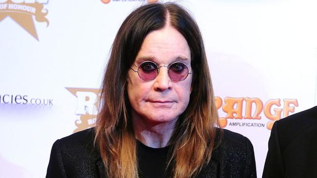 Ozzy Osbourne returned to his native Birmingham to unveil the tram on Corporation Street
