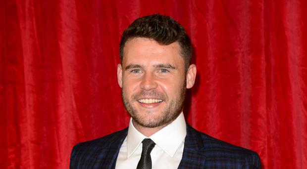 Emmerdale's Danny Miller arrived suited and booted