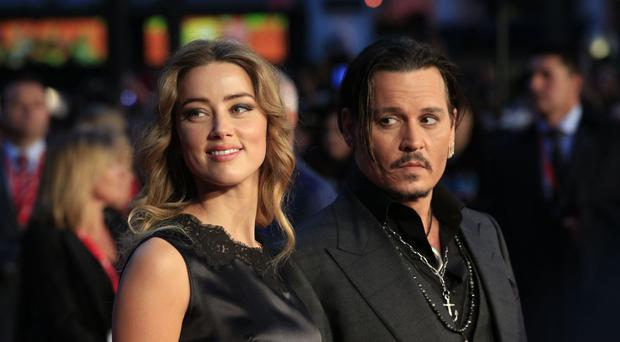 Johnny Depp and his wife Amber Heard, who are divorcing after 15 months of marriage