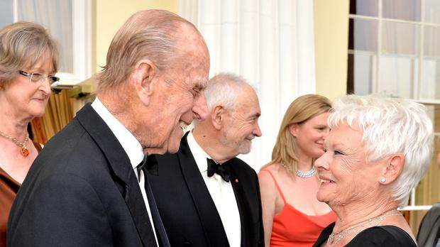 The Duke of Edinburgh greets Dame Judi Dench