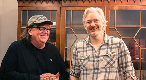 Oscar-winning documentary film-maker Michael Moore meeting WikiLeaks founder Julian Assange