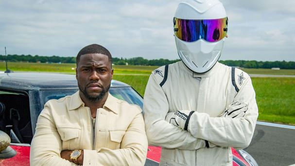 Kevin Hart with The Stig, right, (BBC/PA)