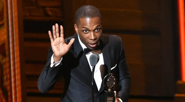 Leslie Odom Jr accepts the award for leading actor in a musical for Hamilton, at the Tony Awards in New York (AP)