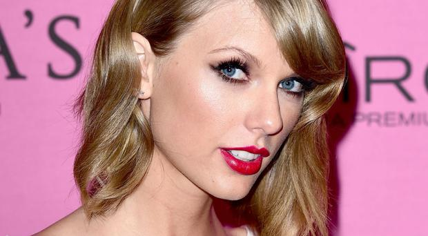 The photographs emerged two weeks after Taylor Swift's split with Scottish DJ Calvin Harris