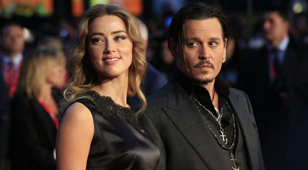 Johnny Depp and his wife Amber Heard