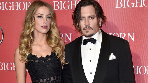 Amber Heard filed for divorce on May 23, citing irreconcilable differences with Johnny Depp (AP)