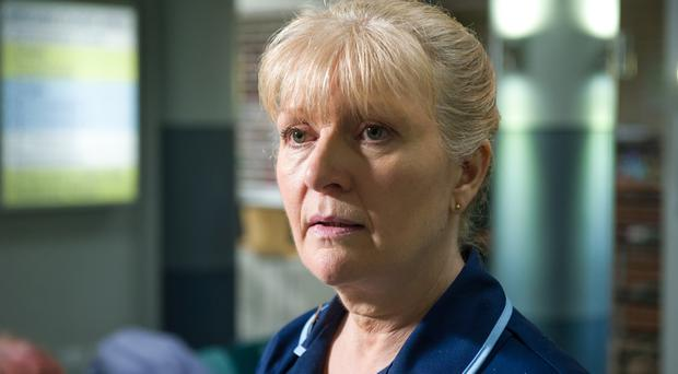 Cathy Shipton will appear as Lisa Duffin in Casualty's 1,000th episode (BBC/PA)