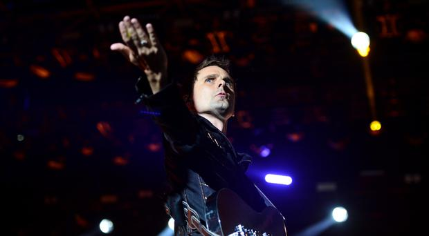 Matt Bellamy of Muse performing at the Glastonbury Festival, at Worthy Farm in Somerset