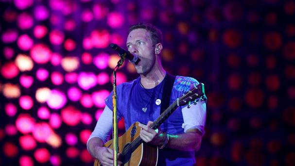 Chris Martin of Coldplay performing live on The Pyramid Stage at the Glastonbury Festival