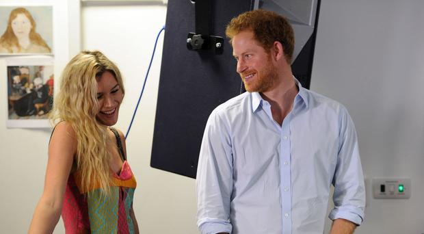Prince Harry and Joss Stone (left) watch members of the Basotho Youth Choir during their rehearsals at the Brit School ahead of a performance at the Sentebale Concert.