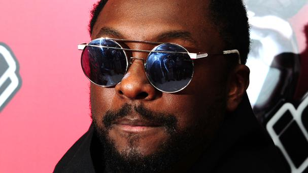 Will.i.am is staying on a a coach on The Voice despite the show's switch to ITV