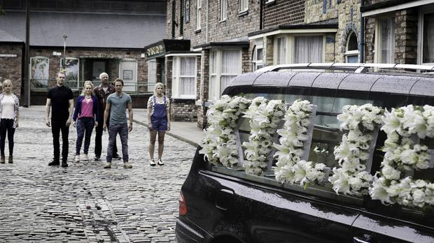 Devastated family and friends looking at a hearse carrying Coronation Street's Kylie Platt (ITV/PA)