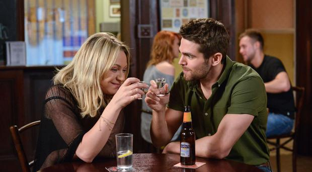 Roxy Mitchell and Andy Flynn having a drink together at The Vic in EastEnders