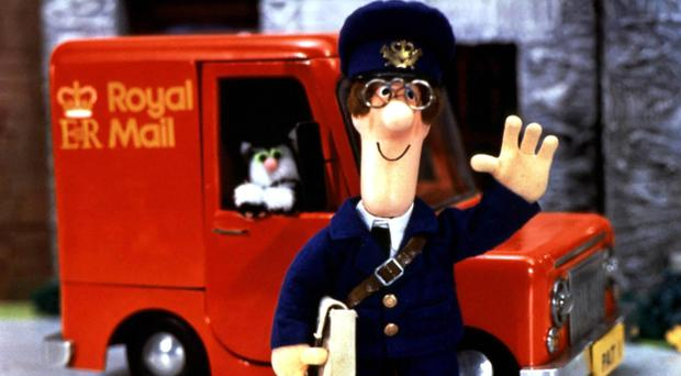 Postman Pat with his black-and-white cat Jess