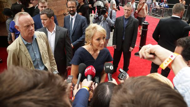 JK Rowling speaks to media upon arriving for the opening gala performance of Harry Potter and The Cursed Child, at the Palace Theatre in London.