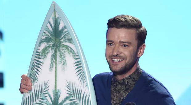 Justin Timberlake accepts the Decade award at the Teen Choice Awards at the Forum in Los Angeles (AP)