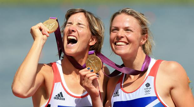 Great Britain's Katherine Grainger (left) and Anna Watkins celebrate winning gold in the women's double sculls at Eton Dorney Rowing Lake, Windsor