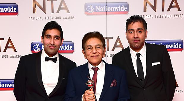 Members of the Siddiqui family with the award for Best Factual Entertainment Show for Gogglebox