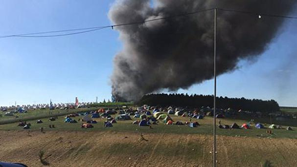 Photo from the Twitter feed of Adam Coppin of the fire in the car park of BoomTown Fair Festival