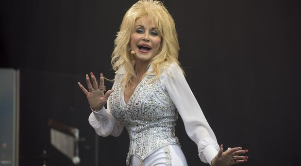 Country singer Dolly Parton is a fan of Adele and wants to work with her