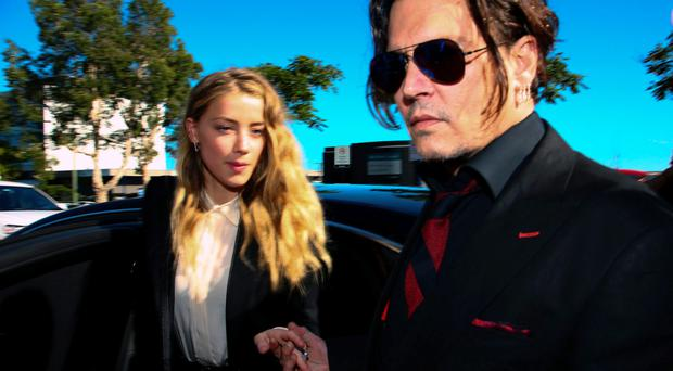 Amber Heard and Johnny Depp have reached a settlement to end their 18-month marriage