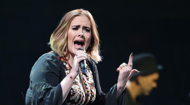 Adele performing at Glastonbury - the superstar had to postpone a US gig because she had a cold