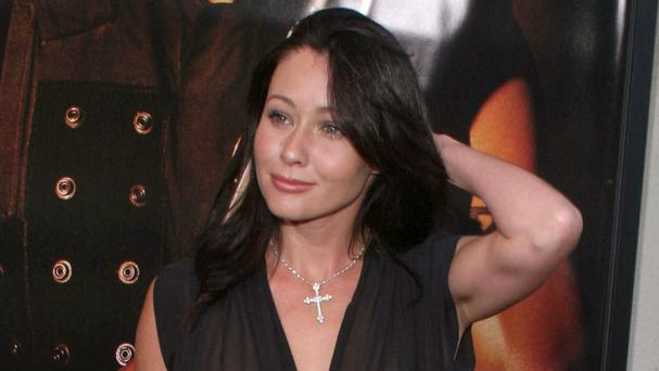 Shannen Doherty has settled with her former business managers