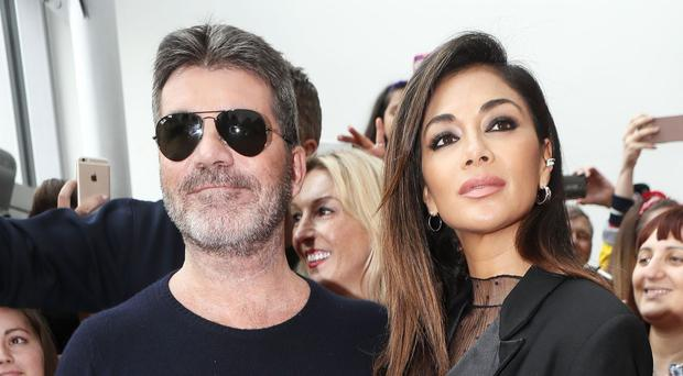 Simon Cowell and Nicole Scherzinger are joined by Louis Walsh and Sharon Osbourne on the X Factor panel