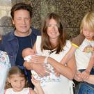 Jools and Jamie Oliver leave the Portland Hospital in central London with the newest addition to the Oliver family