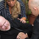 Sharon (Letitia Dean) and Grant (Ross Kemp) see Phil (Steve McFadden) collapse in the dramatic episode