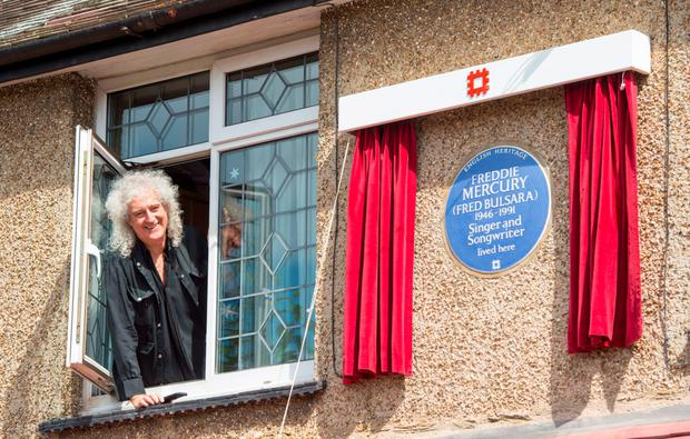 Queen guitarist Brian May unveiling an English Heritage blue plaque at Mercury's childhood home in Feltham, west London