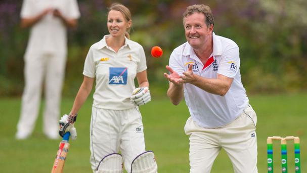 Piers Morgan bowling for the US team during the UK Press v US Press cricket match hosted by US Ambassador Matthew Barzun at his official residence, Winfield House in central London.