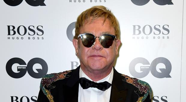 Sir Elton John in the press room at the GQ Men of the Year Awards