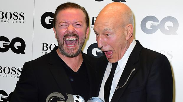 Ricky Gervais with Patrick Stewart in the press room at the GQ Men of the Year Awards