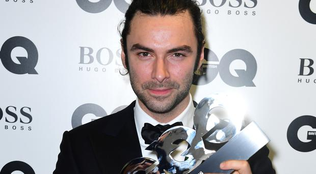 Aidan Turner with the award for best television actor in the press room at the GQ Men of the Year Awards