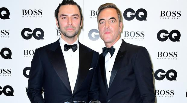 James Nesbitt presents Aidan Turner with the award for Best Television Actor in the press room at the GQ Men of the Year Awards 2016
