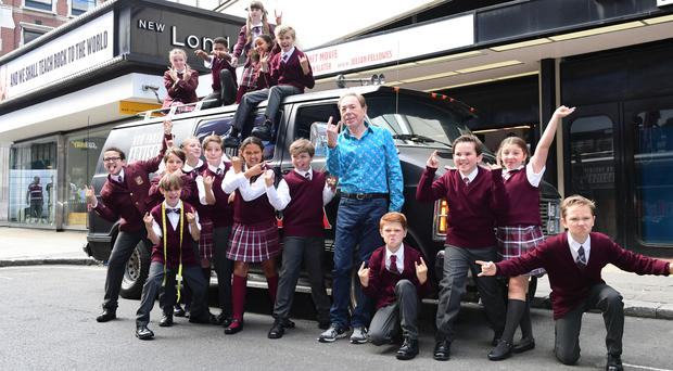 Andrew Lloyd Webber and the cast of School Of Rock outside the New London Theatre, London, for the launch of the musical