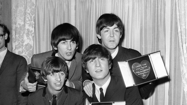 The four band members were able to help each other through Beatlemania, Ringo Starr said