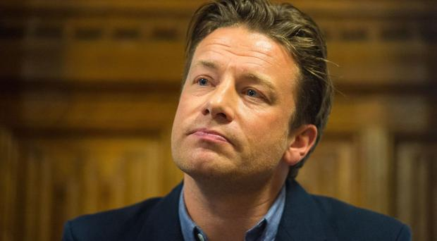 Jamie Oliver insisted he would have his hands full with his own projects