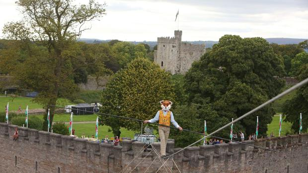 High wire walker Chris Bullzini walks from Cardiff Castle as Fantastic Mr Fox as part of 'Roald Dahl's City of the Unexpected' celebration