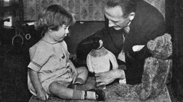 AA Milne and Christopher Robin Milne playing with a toy teddy bear as a new Winnie-the-Pooh character, inspired by the photograph, has been unveiled (Culture Club/Egmont Publishing/PA)