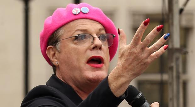 Eddie Izzard making a speech in his pink beret at the rally