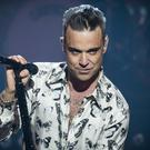 Robbie Williams' new release, Heavy Entertainment Show, was unveiled during the X Factor commercial break
