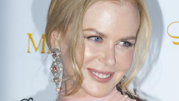 Nicole Kidman said she found being a mother of four a very emotional challenge