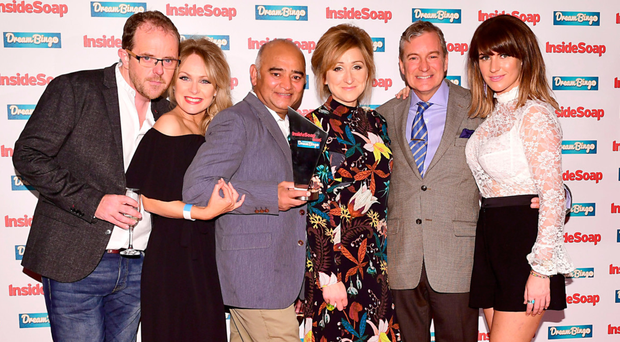Emmerdale's Liam Fox, Michelle Hardwick, Bhasker Patel, Charlotte Bellamy, John Middleton and Laura Norton pose with the award for best soap