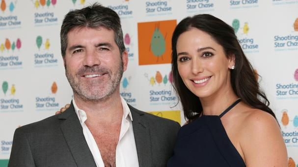 Simon Cowell, girlfriend Lauren Silverman and their two year-old son were asleep at the time of the break-in