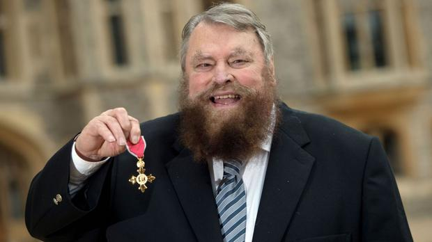 Actor Brian Blessed has been made an OBE by the Queen at Windsor Castle
