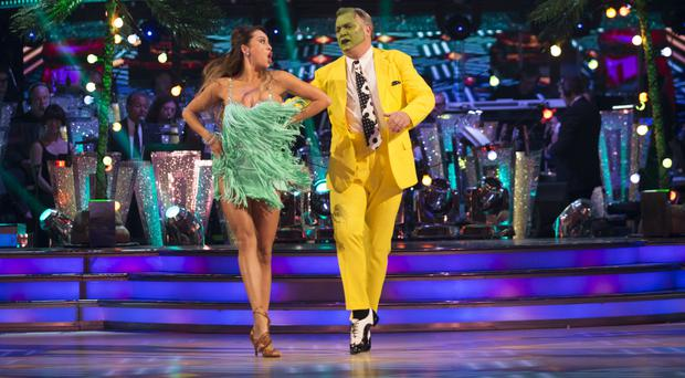 Ed Balls and partner Katya Jones perform a routine inspired by The Mask as they make it through to the next round of Strictly